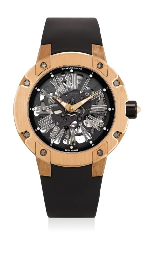 A fine and attractive pink gold skeletonized wristwatch