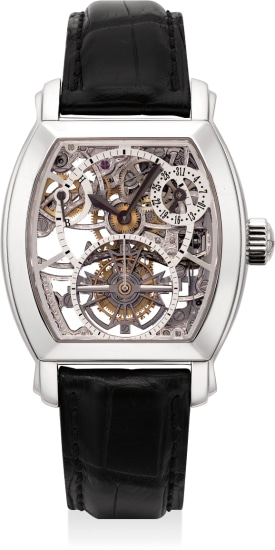 An extremely fine and rare platinum skeletonized tourbillon wristwatch with date and power reserve.