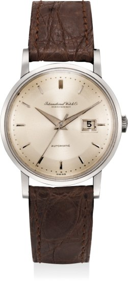 A highly attractive white gold wristwatch with date and center seconds