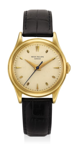 An attractive yellow gold wristwatch with center seconds
