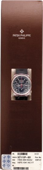 A rare and superlative platinum and ruby-set perpetual calendar chronograph wristwatch with moonphase and leap year indication, with original presentation box, certificate of warranty and in original factory double seal