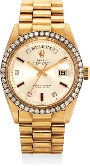 A rare and fine pink gold calendar wristwatch with diamond-set bezel and hour markers, with bracelet