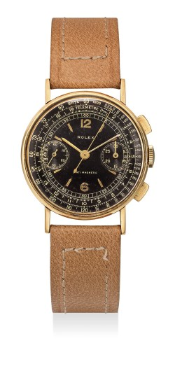 A very rare and attractive yellow gold chronograph wristwatch with black dial