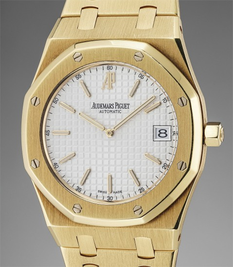 A fine and very rare yellow gold automatic wristwatch with date and bracelet