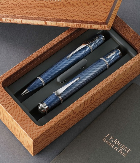 A limited edition set of platinum, titanium and blue enamel writing instruments, composed of a ballpoint and a fountain pen presented in its original box