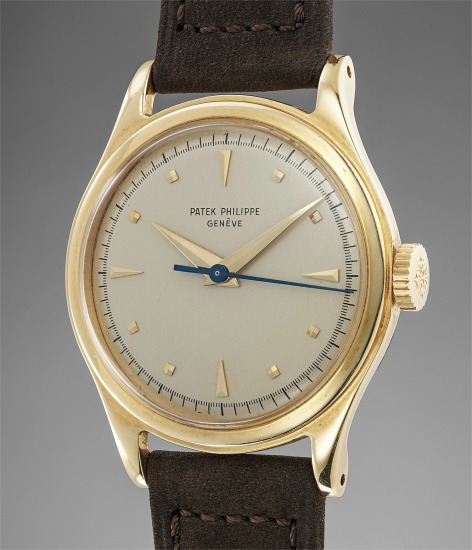 A fine yellow gold wristwatch with sweep center seconds