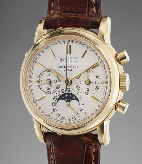 A fine and attractive yellow gold perpetual calendar chronograph wristwatch with moonphases