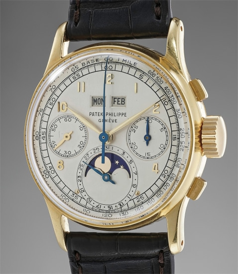 An exceedingly rare and extremely well-preserved yellow gold perpetual calendar wristwatch with moonphases and bracelet