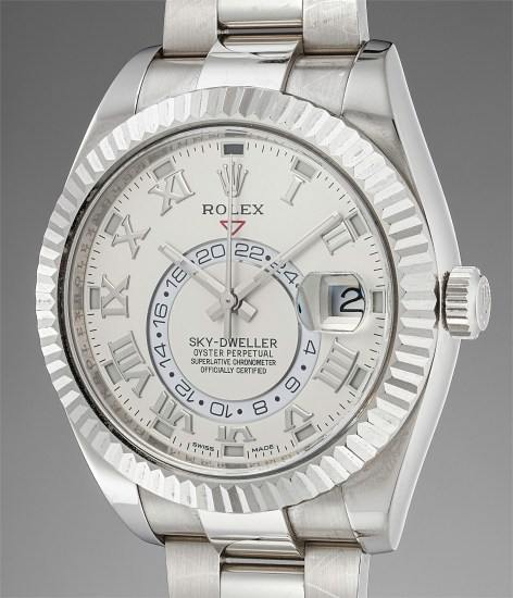 A very attractive white gold dual time zone annual calendar wristwatch with bracelet, guarantee card and presentation box
