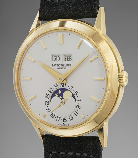 An incredibly well-preserved yellow gold perpetual calendar wristwatch with moonphases and original certificate and box