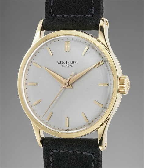 A rare and attractive yellow gold wristwatch with center seconds and box