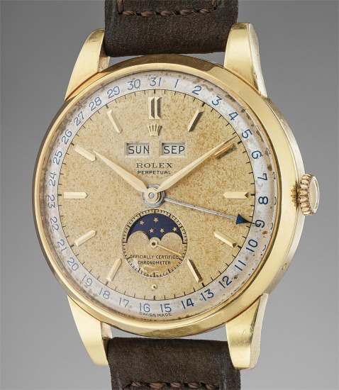 A rare and attractive yellow gold triple calendar wristwatch with moonphases and two-tone dial