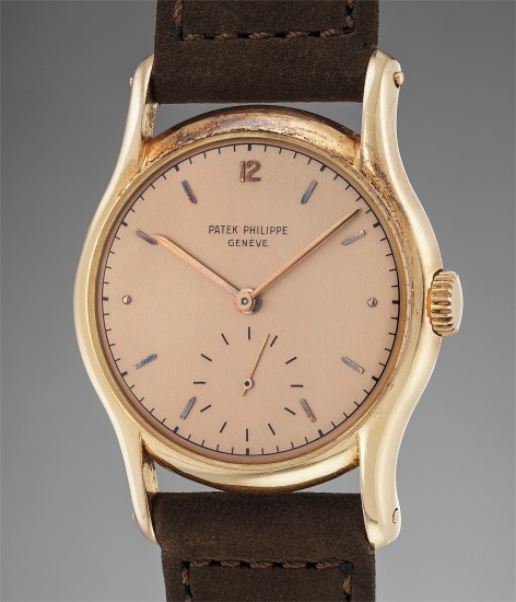 A rare and attractive pink gold wristwatch with pink dial and elongated lugs