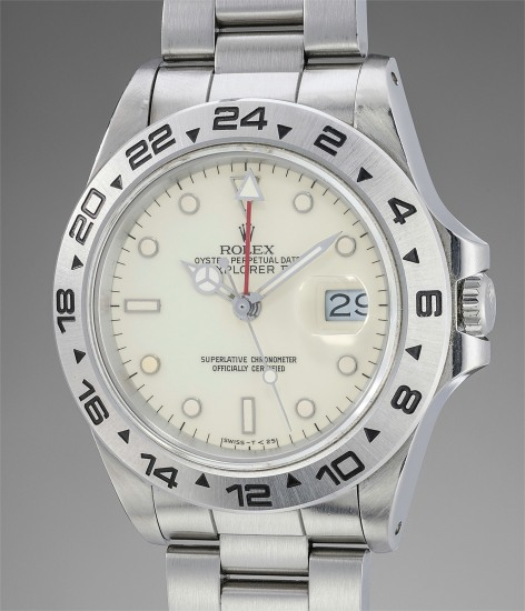 """A very fine and rare stainless steel wristwatch with 24-hour indication and cream """"rail"""" dial"""