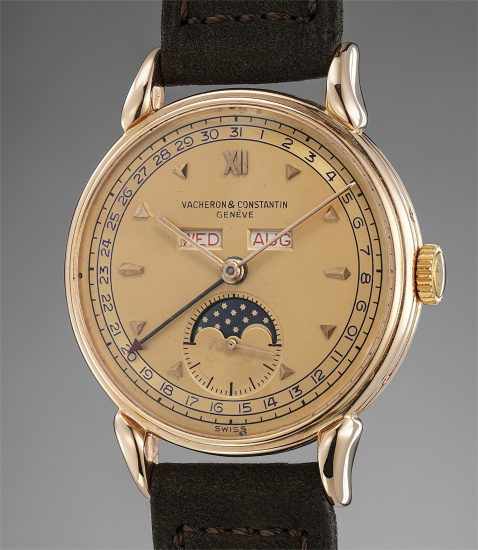 A fine and very rare pink gold triple calendar wristwatch with moonphases and pink two-tone dial