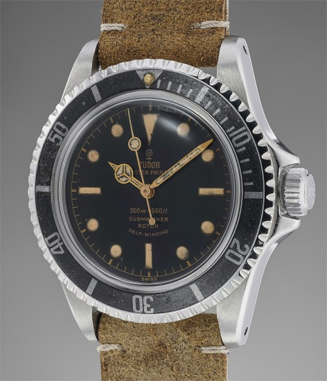 A rare and early stainless steel diver's wristwatch with gilt dial and pointed crown guards