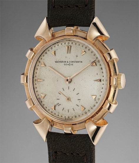 An extravagant and very distinctive pink gold wristwatch with fancy case shape