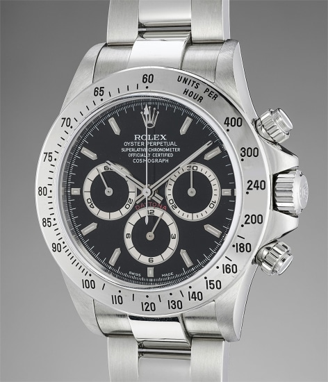 A fine, attractive and extremely well preserved stainless steel automatic chronograph wristwatch with bracelet and guarantee