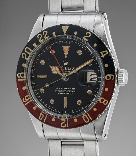 A rare and extremely well-preserved stainless steel wristwatch with bracelet, dual time, bakelite bezel, box and papers