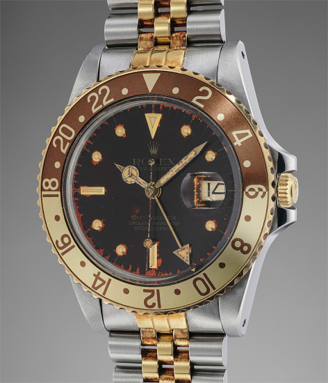 A stainless steel and yellow gold dual time wristwatch with center seconds, date, bracelet, hang tag, guarantee, original receipt and fitted presentation box