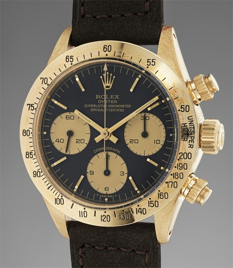 A very rare and attractive yellow gold chronograph wristwatch with black dial and champagne registers