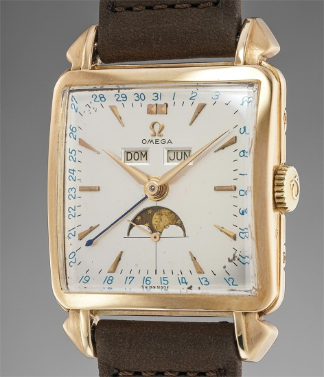 A fine and very rare 14K yellow gold square triple calendar wristwatch with moonphases and fancy lugs