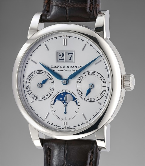 A fine and rare white gold automatic annual calendar wristwatch with moonphases, zero-reset function, Guarantee and box