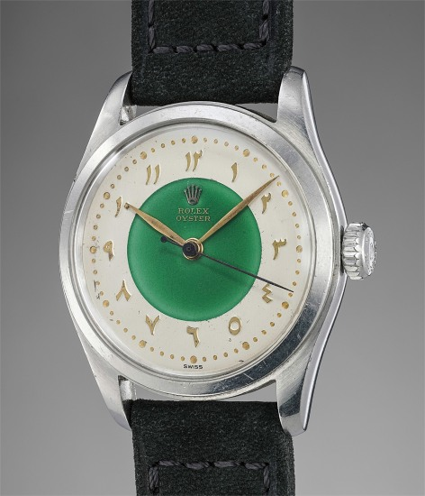 A rare and attractive stainless steel wristwatch with green enamel dial and Eastern Arabic numerals