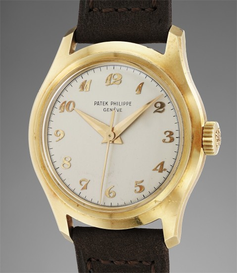 A very fine and rare yellow gold wristwatch with center seconds and Breguet numerals
