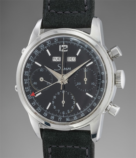 A fine and very attractive stainless steel chronograph wristwatch with triple calendar and black glossy dial