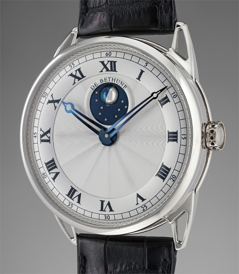 A very rare and unusual white gold wristwatch with silver guilloché dial and three dimensional moonphase display