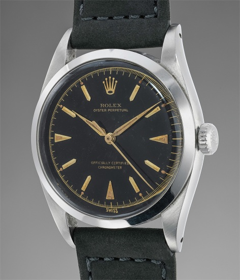 An extremely attractive stainless steel wristwatch with black glossy dial and yellow gold applied indexes