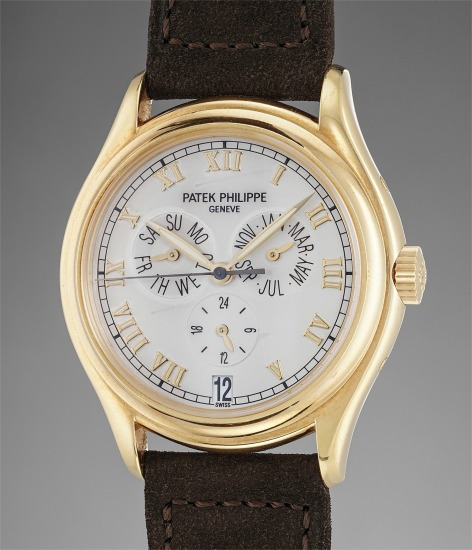 A fine and attractive yellow gold annual calendar automatic wristwatch with center seconds and 24-hour indication