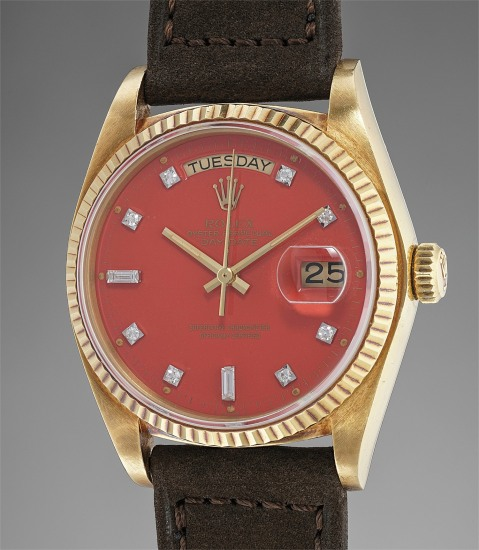 """A rare and extremely well-preserved yellow gold calendar wristwatch with red lacquer """"Stella"""" dial, numbered sales tag, original guarantee and presentation box"""