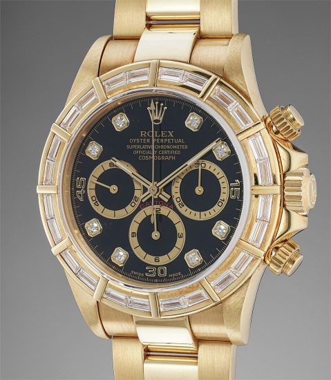 A very rare and attractive yellow gold and diamond-set chronograph wristwatch with bracelet