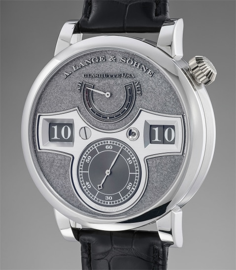 A very attractive limited edition platinum wristwatch with jumping hour, box and guarantee