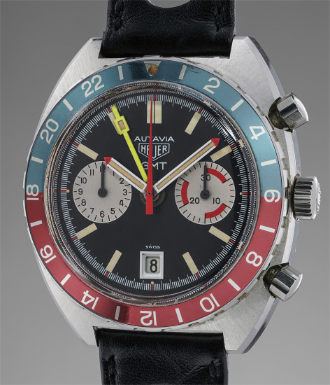 A stainless steel chronograph wristwatch with dual time zone indication, date and bright yellow GMT second time zone hand