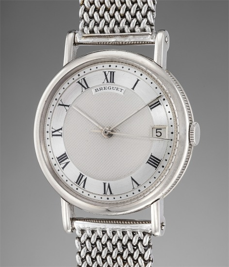 A very rare and fine white gold automatic wristwatch with date and white gold bracelet