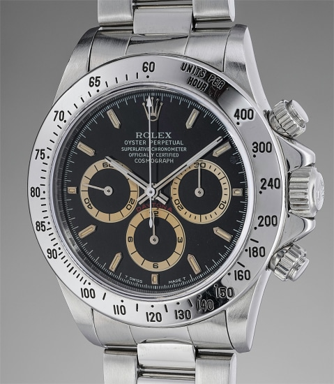 """A rare and attractive stainless steel chronograph wristwatch with brown """"tropical"""" registers, bracelet, guarantee and presentation box"""
