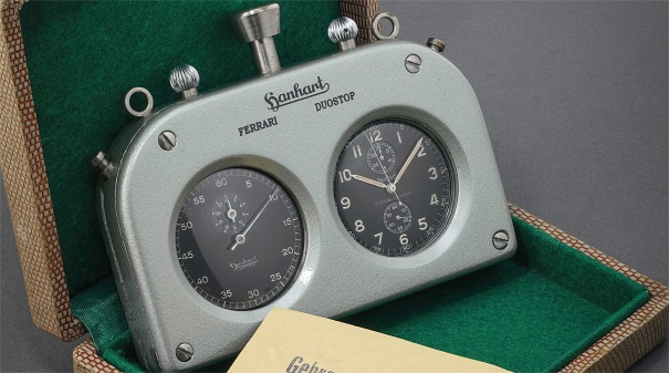 A rare stainless steel rally timer composed of two chronograph watches in a control case made for Ferrari