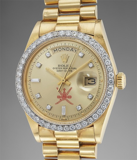 A very rare yellow gold calendar wristwatch with diamonds bezel and hour markers, bracelet made for the Sultanate of Oman
