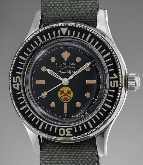 A large and attractive stainless steel diver's wristwatch with no radiation black glossy dial, retailed by Aqua Lung