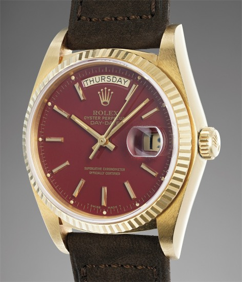 """A fine and attractive yellow gold calendar wristwatch with burgundy lacquer """"Stella"""" dial"""