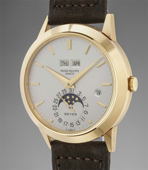 A rare, attractive and exceptionally well preserved yellow gold perpetual calendar wristwatch with moonphases, leap year indicator and fitted presentation box