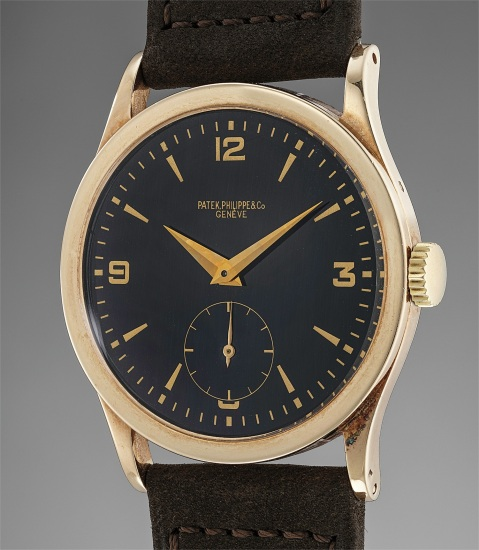 A possibly unique and well-preserved 14K yellow gold wristwatch with black lacquered dial
