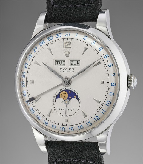 A rare and well-preserved stainless steel triple calendar wristwatch with moonphases