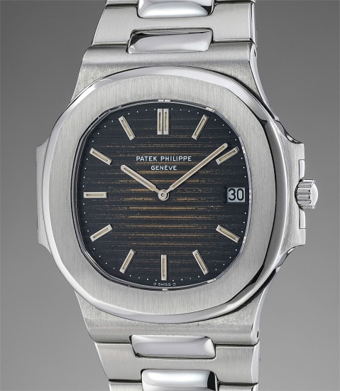A very attractive and rare stainless steel wristwatch with date, tropical dial and bracelet