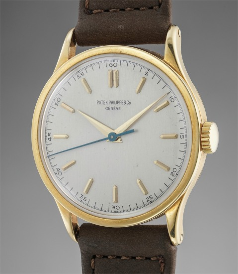 A rare and attractive yellow gold wristwatch with indirect center seconds