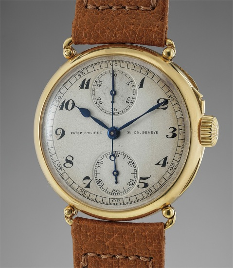 An extremely rare, well preserved and historically important yellow gold single pusher chronograph wristwatch with vertical registers and officer case