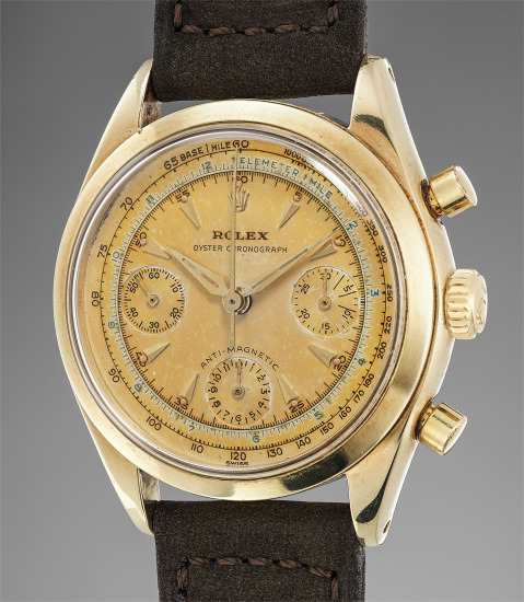 A very fine and rare 14K yellow gold chronograph wristwatch with multi-scale tropical champagne dial and engraved back